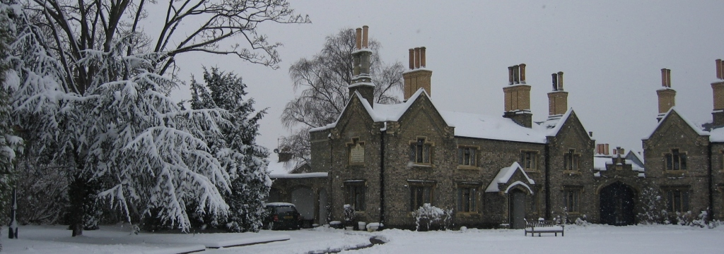 Photo of picturesque stone buildings in snow