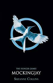 Book cover: Mockingjay - Suzanne Collins (silver-blue stylised mockingjay on a circle)