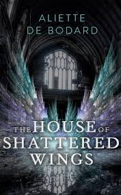 Book cover: The House of Shattered Wings - Aliette de Bodard (silvery wings spread wide in front of a Gothic arch window)