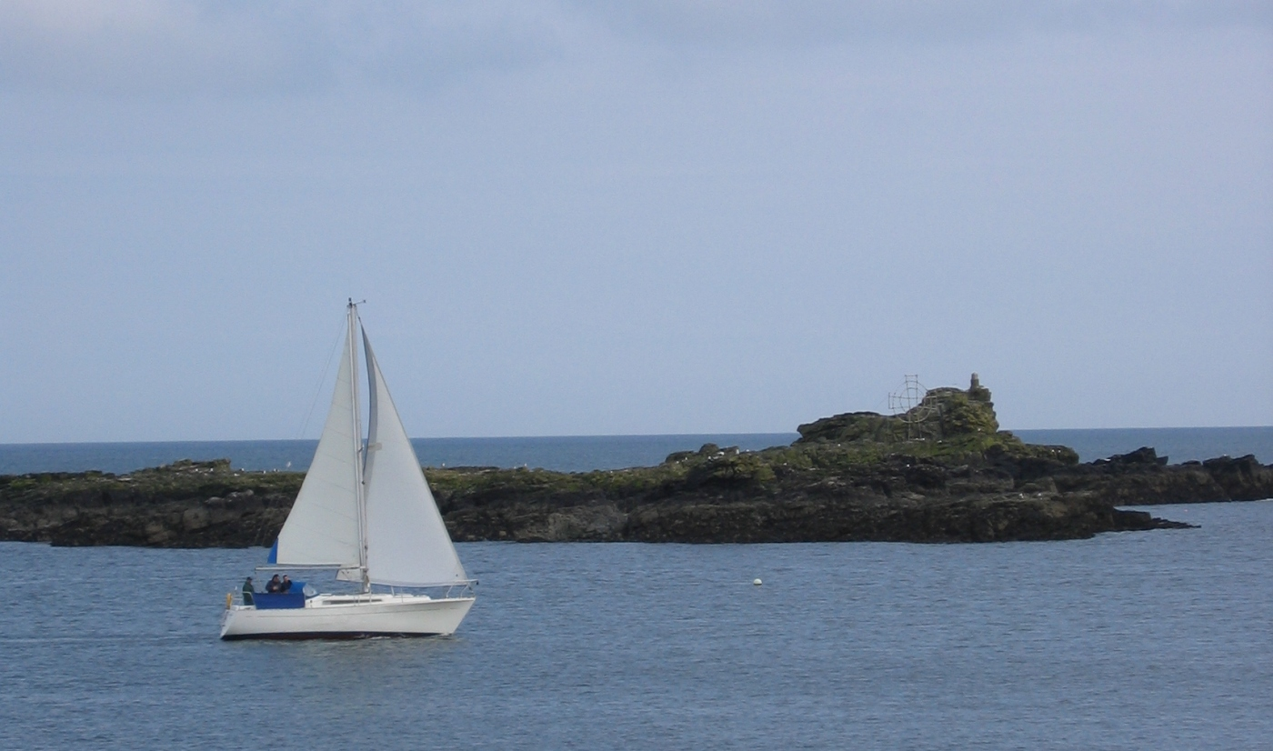 Yacht sails out of Cornish harbour