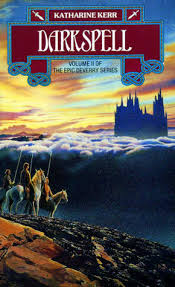 Book cover: Darkspell - Katharine Kerr (a group on horseback sit atop a hill staring over clouds at a distant castle)