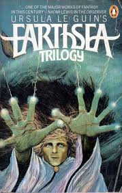 Book cover: The Earthsea Trilogy - Ursula Le Guin (a young man casts lightning from his fingertips against a stormy sea)