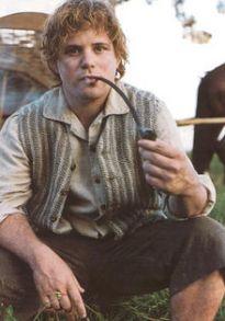 Sean Astin as Samwise, smoking a pipe