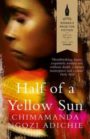 Book cover: Half of a Yellow Sun - Chimamanda Ngozi Adichie (a woman in profile, blurred, wearing yellow and red)