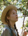 Anne Shirley - still from tv show, a young red-headed girl in a straw hat looking up