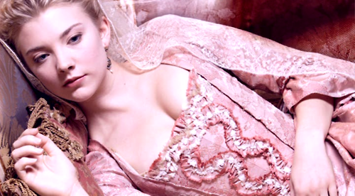 Natalie Dormer in a fabulous pink dress, reclining on a chaise longue