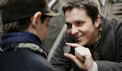 An unusually cheerful Christian Bale as Borden delighting a kid with tricks on the street in The Prestige