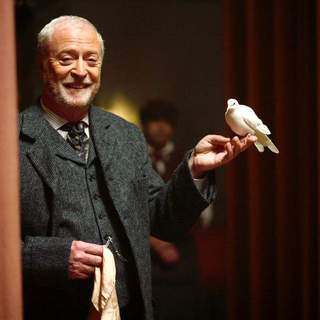 Michael Caine as Alfred - sorry, Cutter - in The Prestige. Holding a dove.