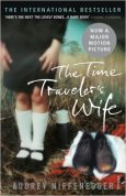 Book cover: The Time Traveler's Wife - Audrey Niffenegger (a child's legs as she stands next to an empty pair of man's shoes)