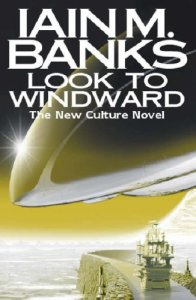 Book cover: Look to Windward - Iain M Banks (the nose of a spaceship reflecting light as it cuts across the top of a scene featuring a tall ship sailing down a canal on a ringworld. Yes this is as crazy as it sounds, in tones of yellow gold)
