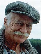 Richard Farnsworth as Matthew Cuthbert, smiling from under his big moustaches
