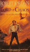 Book cover: Lord of Chaos - Robert Jordan a redhead in a billowy white shirt and tight trousers looking down on a cloaked woman
