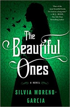 Book cover: The Beautiful Ones - Silvia Moreno-Garcia (a silhouette of a long-haired woman ins a gown against a green background)