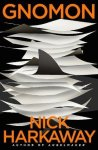 Book cover: Gnomon - Nick Harkaway (pieces of paper drifting against a black background; the outline of a shark fin in the centre)