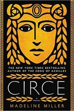 Book cover: Circe - Madeline Miller (a golden Greek mask face, as if wood cut or carved)