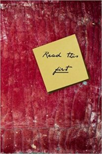 Book cover: Read this first - AC Macklin et al (a textured red background with a post-it note of the title)