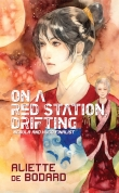 Book cover: On a Red Station Drifting - Aliette de Bodard (a woman with her hair up in a red robe glares off-page; another in green stares out)