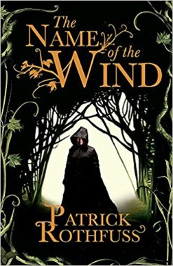 Book cover: The Name of the Wind - Patrick Rothfuss (a hooded figure in a wooded way)