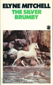 Book cover: The Silver Brumby - Elyne Mitchell (a beautiful silver-grey horse splashes through a pool at the bottom of a cliff)