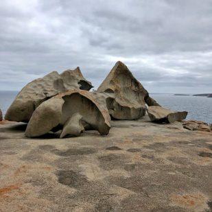 Orange-speckled rocks naturally sculpted in shapes like ceramic modern art