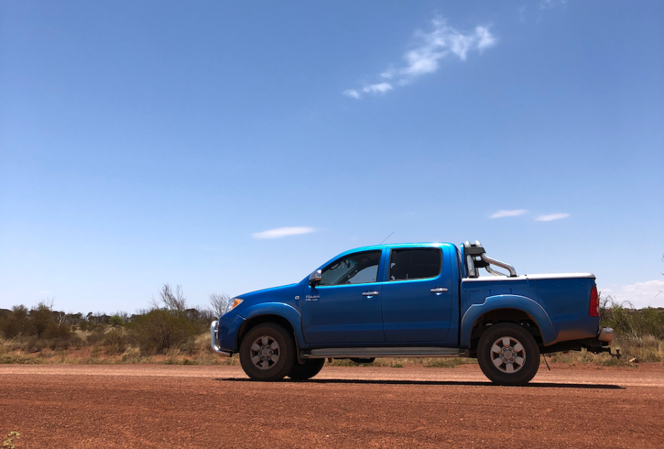 Blue dual-cab Hilux in the Outback