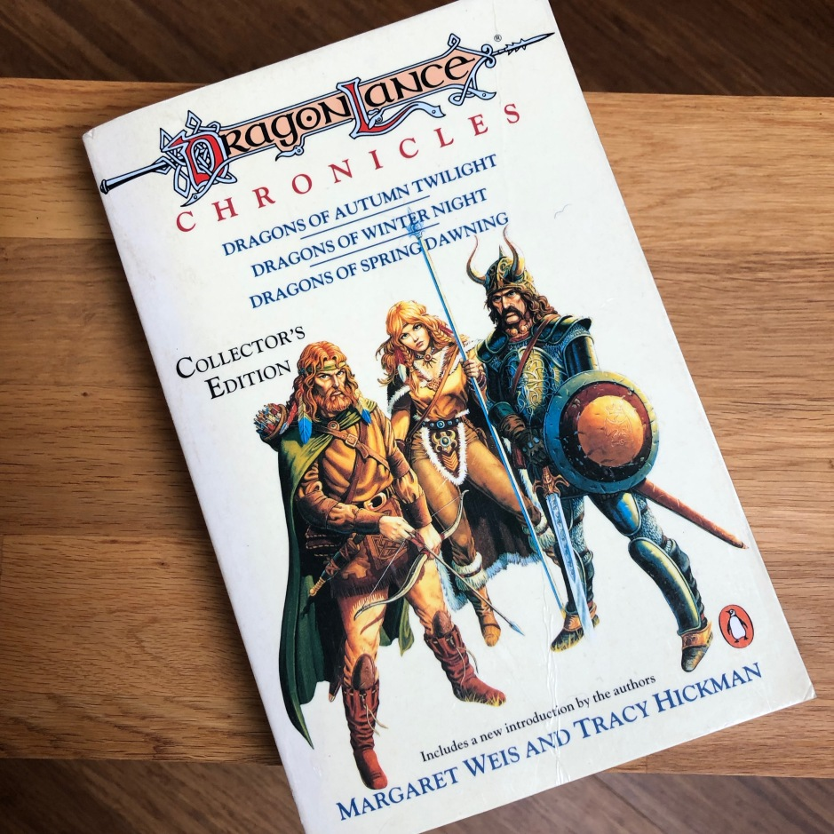 Book on a table: Collector's Edition of the Dragonlance Chronicles featuring Tanis, Goldmoon and Sturm