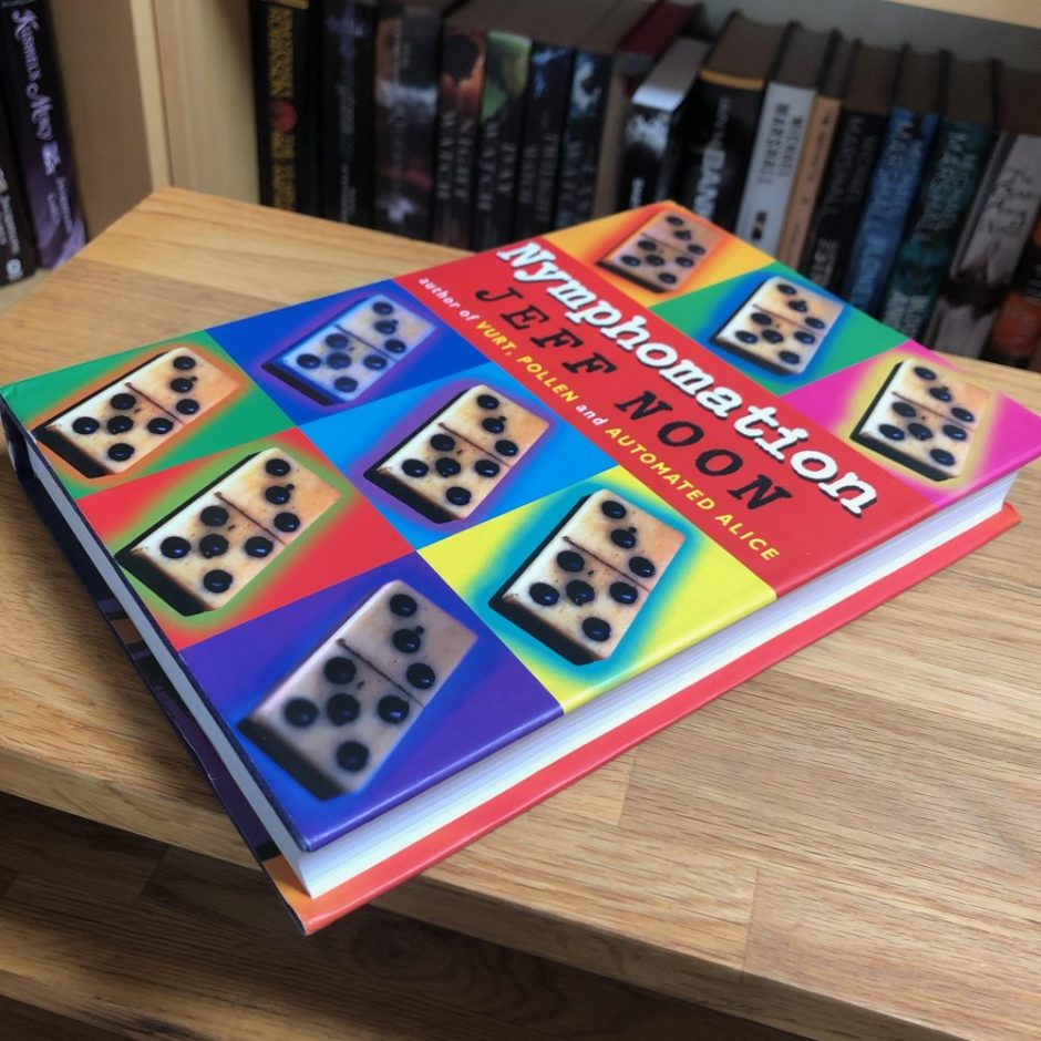 Book on a table: first edition hardback of Nymphomation by Jeff Noon