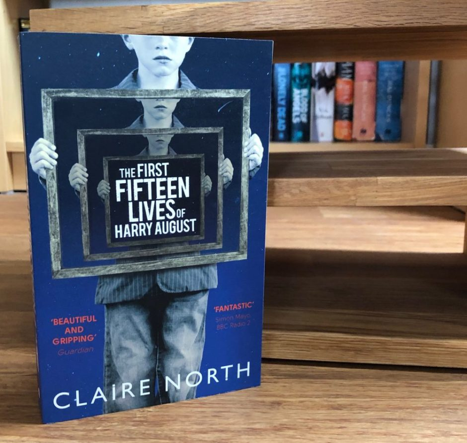 Book: The First Fifteen Lives of Harry August by Claire North stood on its end on the floor