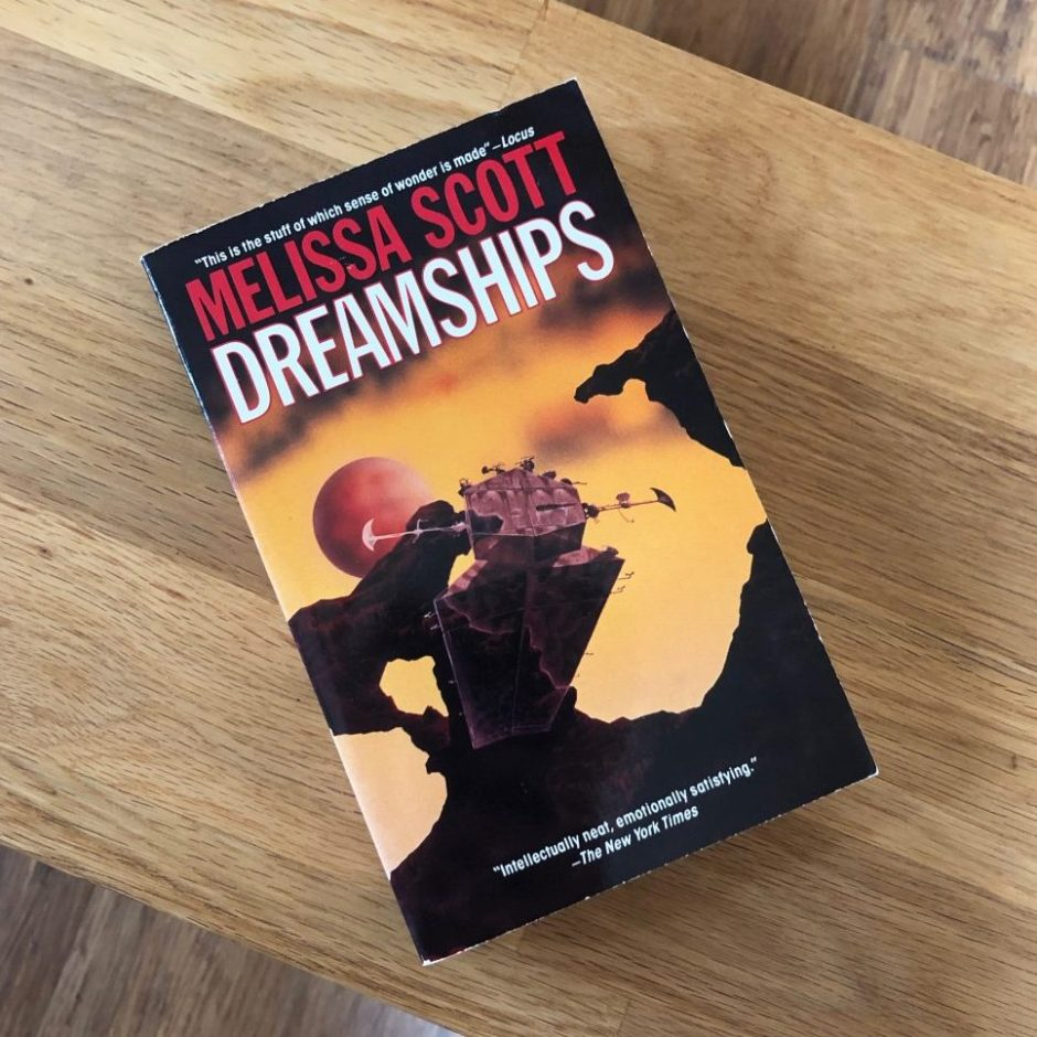 Book on a table: Dreamships by Melissa Scott