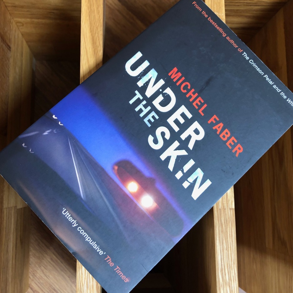 Book on a table: Under the Skin by Michel Faber