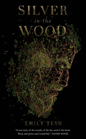 Book cover: Silver in the Wood - Emily Tesh (a bearded man's face depicted in organic leafy fashion)