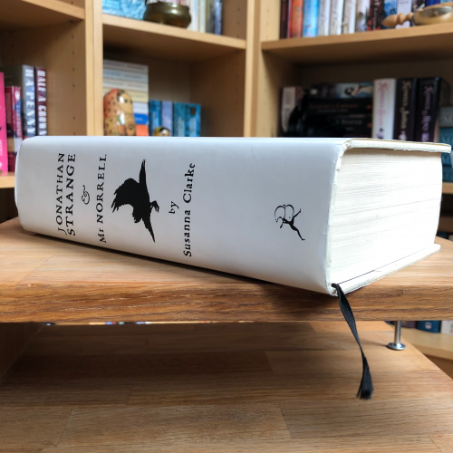 Hardback book lying on a table, spine-on - Jonathan Strange and Mr Norrell by Susanna Clarke
