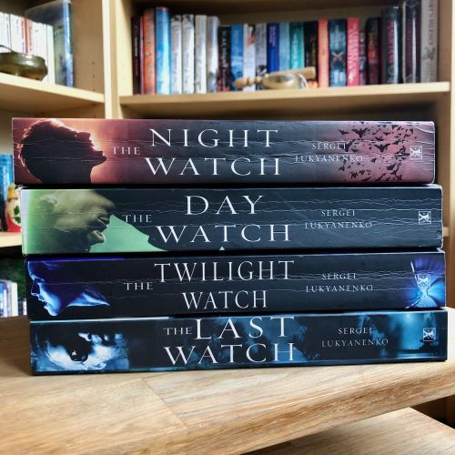 The Night Watch series stacked on a table